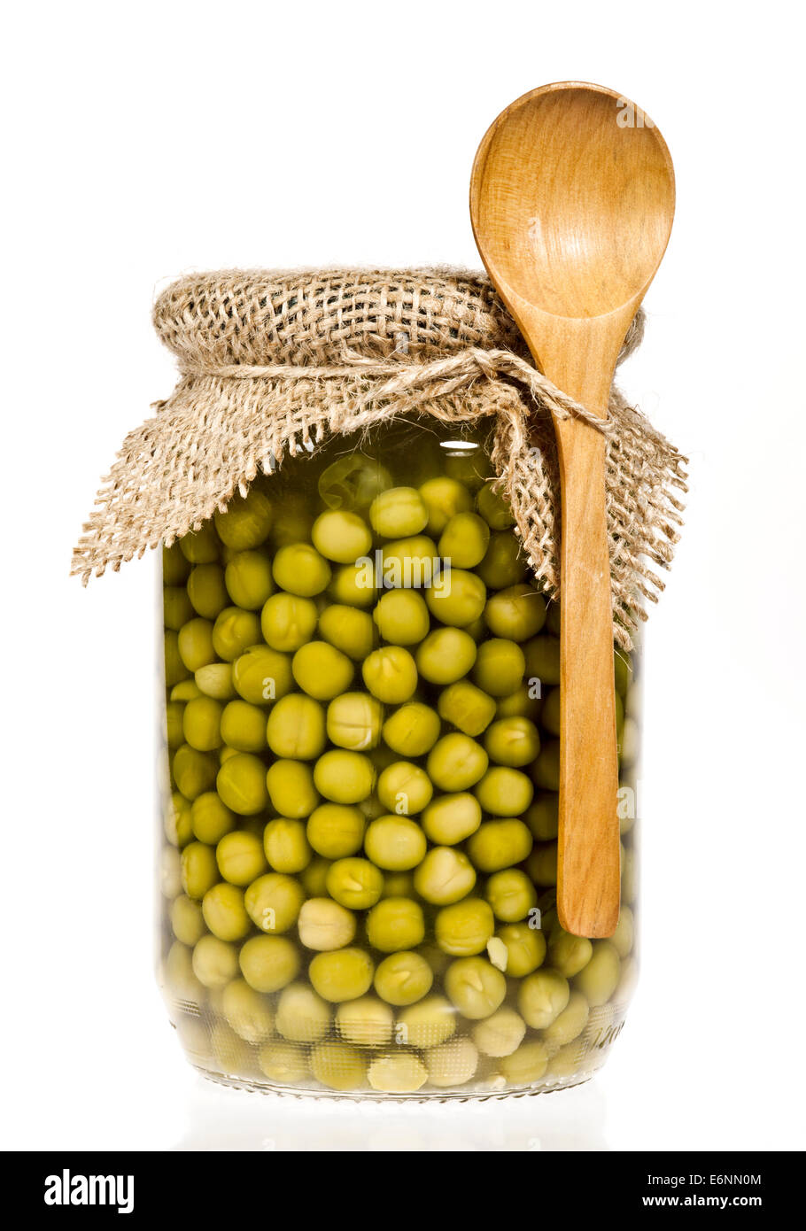 Glass jar of preserved peas on a white background. Stock Photo
