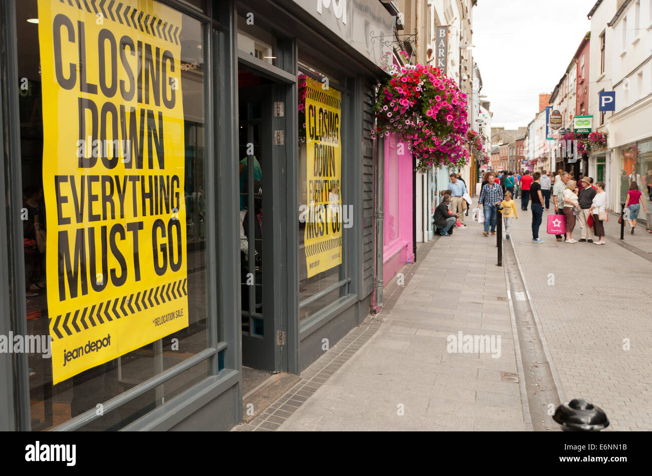 Closing Down Sale Signs in High Street Shop Windows Wexford Town Ireland - Stock Image