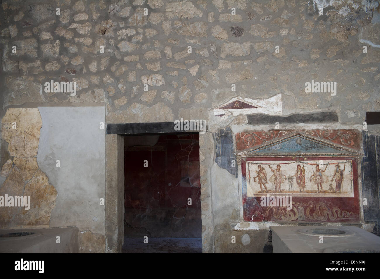 Internal wall drawings or paintings in the ruined city of Pompeii. Stock Photo
