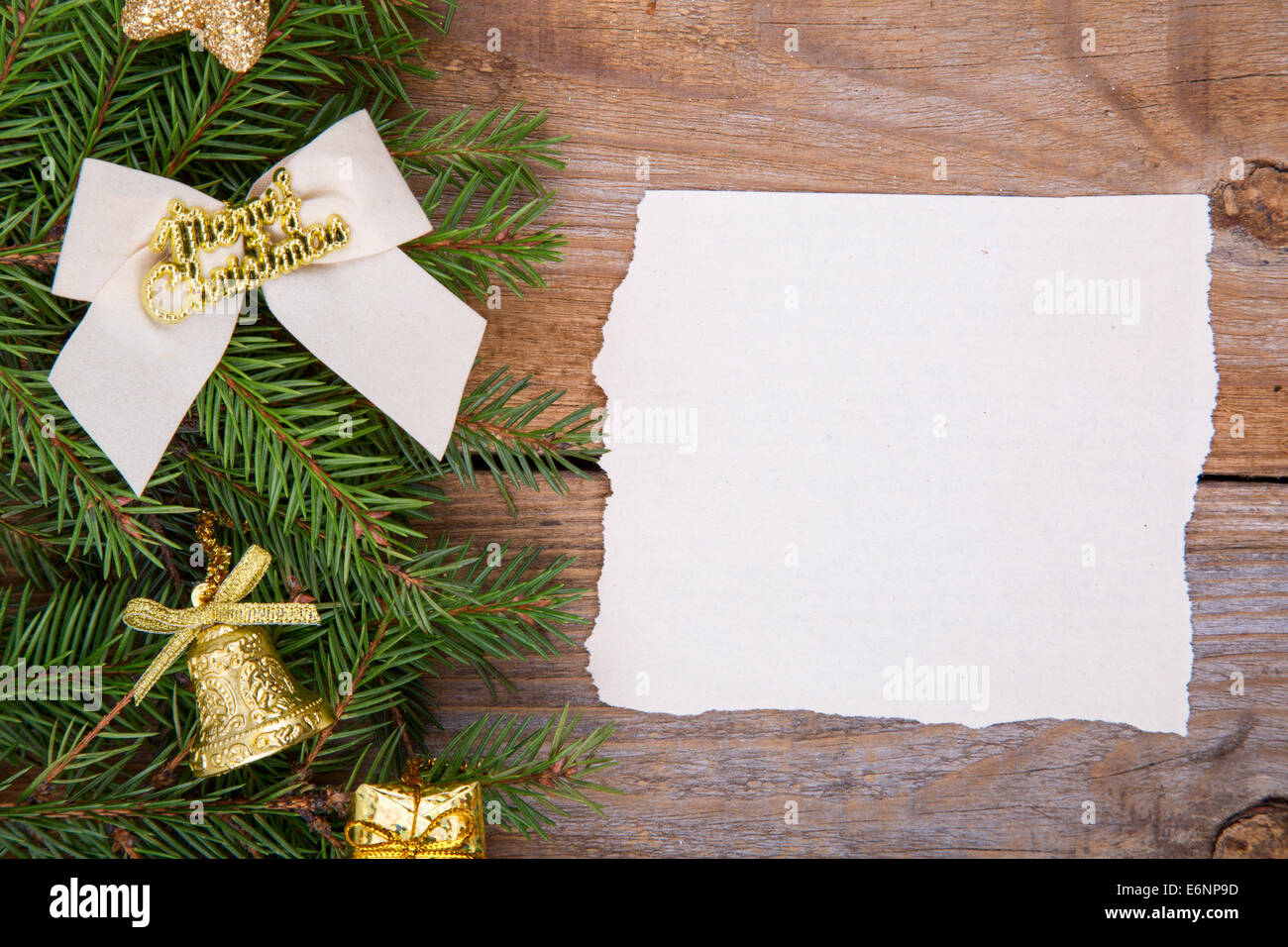 blank christmas card or invitation with gold envelope surrounded by