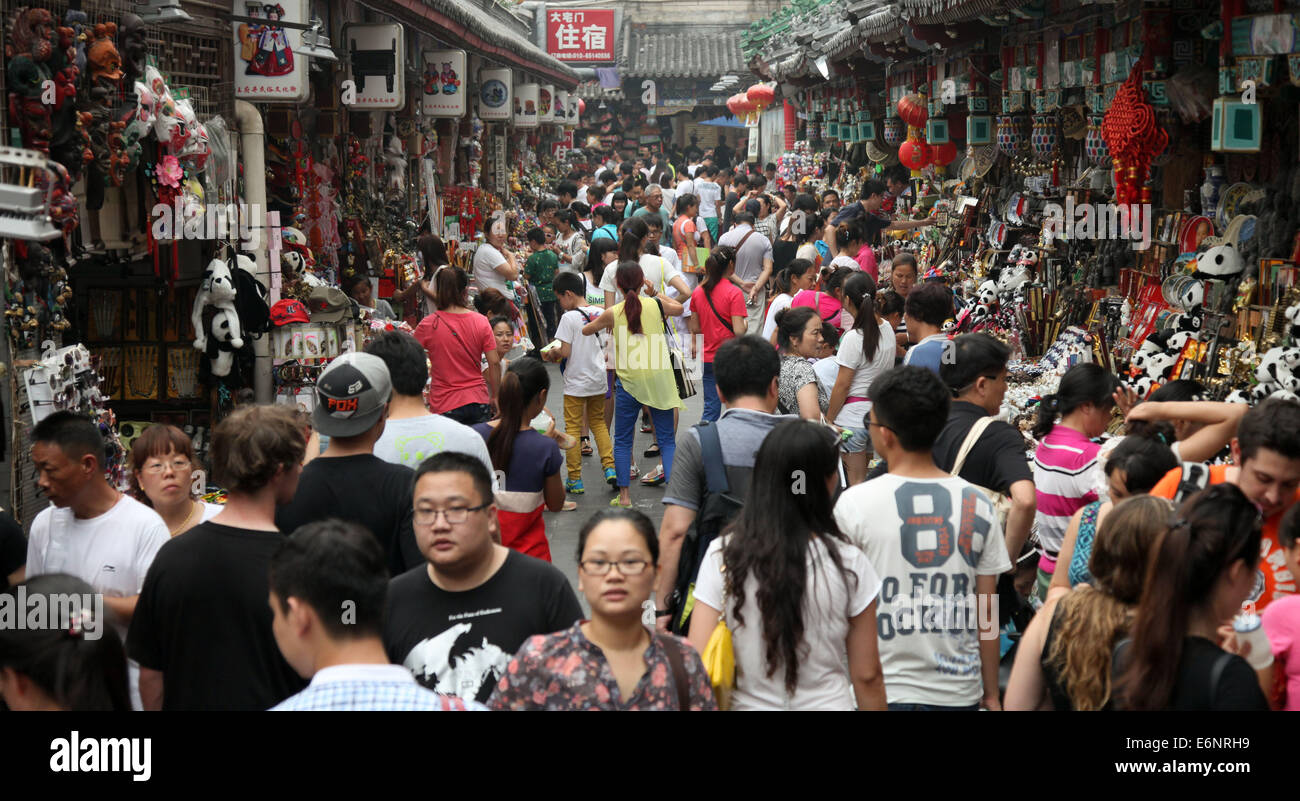 People visit a market in Beijing, China, 04 July 2014. Photo: Friso Gentsch/dpa - Stock Image