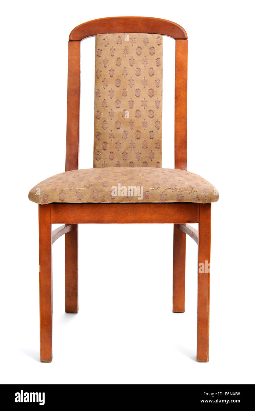 an old and stained chair on a white background - Stock Image