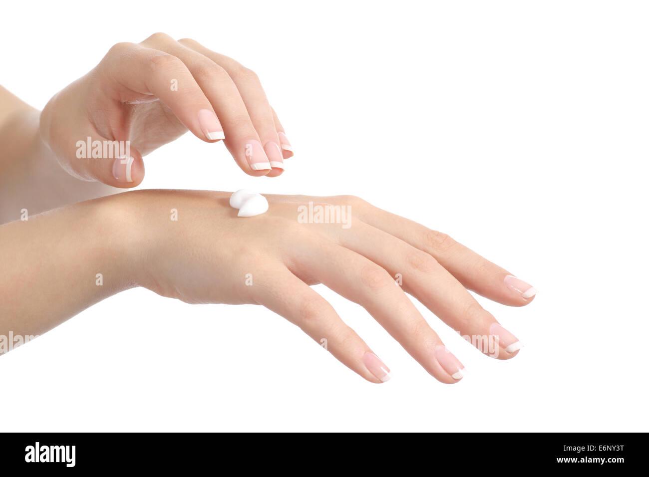 Woman hands with perfect manicure applying moisturizer cream isolated on a white background - Stock Image