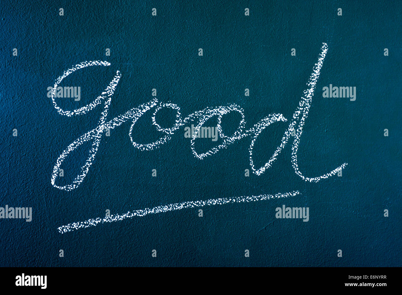 the word good written with chalk on a chalkboard - Stock Image