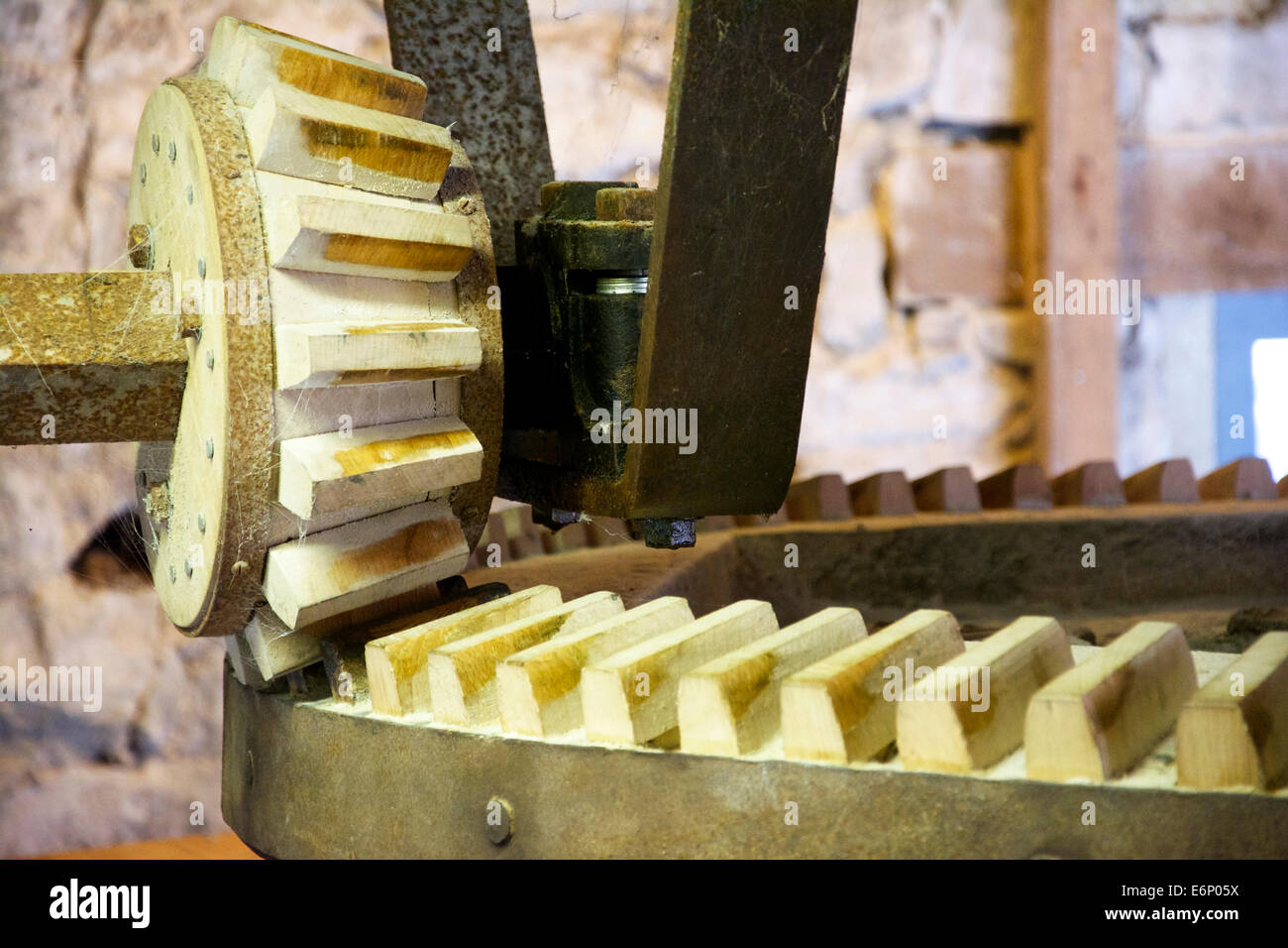 Old machinery. A wooden cog wheel found in a mill. Medieval high tech. - Stock Image