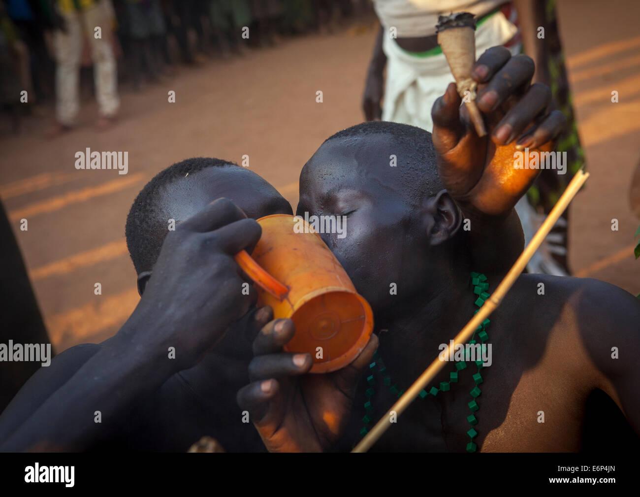 Majang Tribe Men Drinking For A Celebration, Kobown, Ethiopia - Stock Image