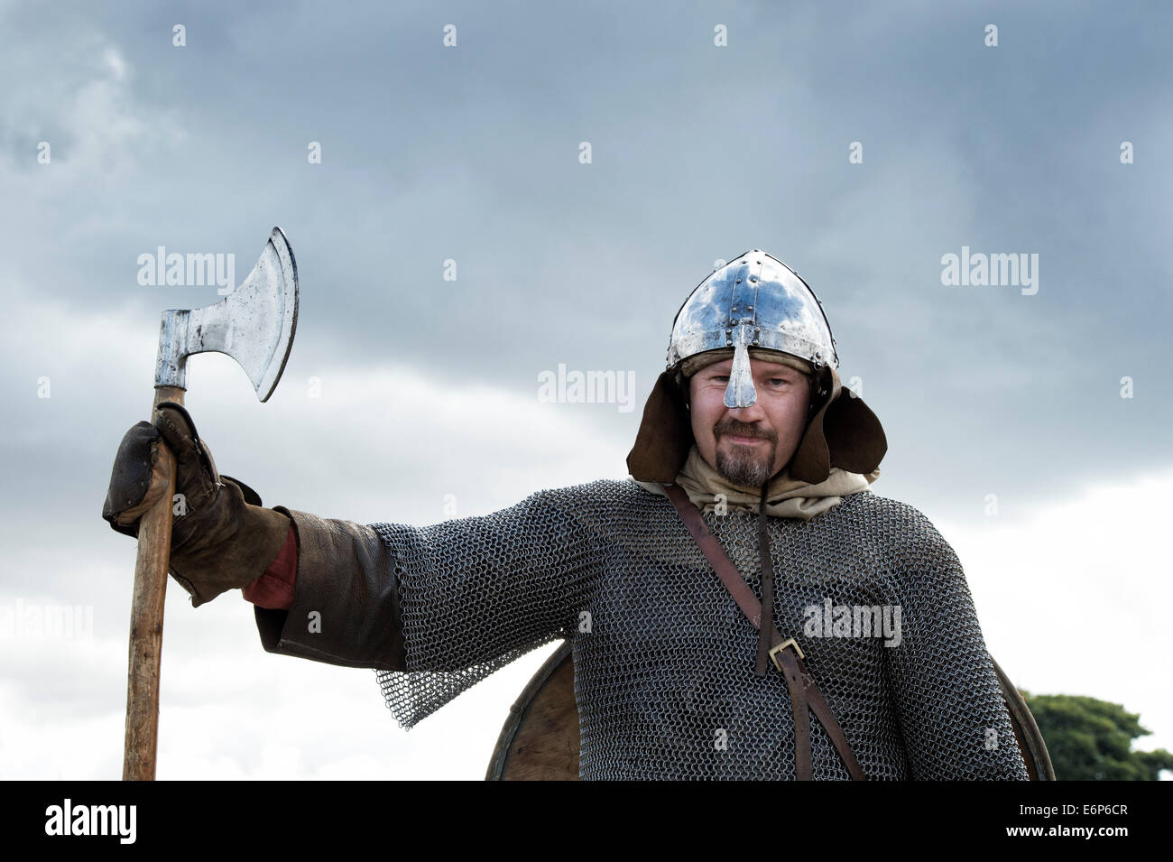 Viking wearing armor and carrying an axe at a historical reenactment. UK - Stock Image