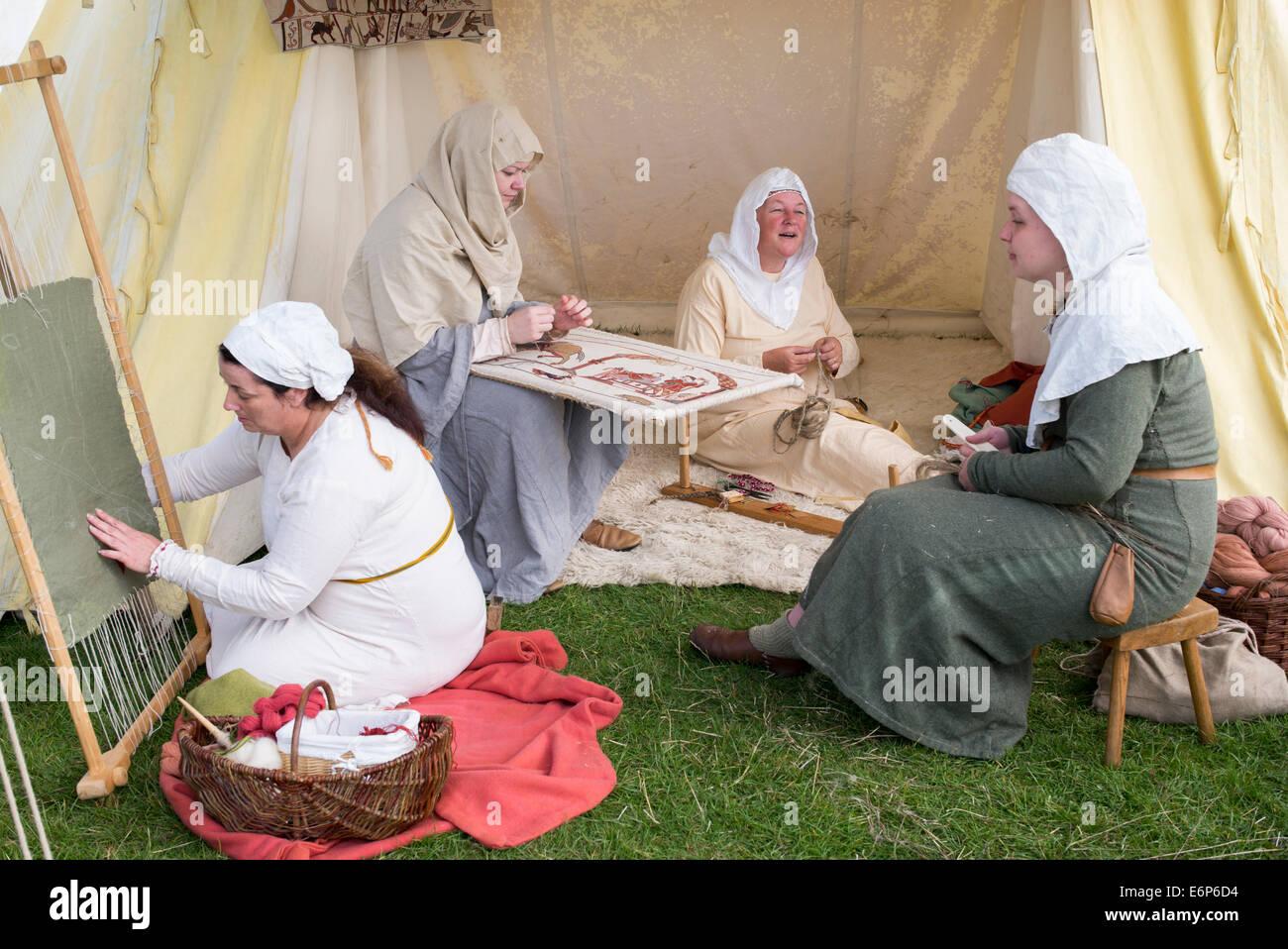 Viking women making Tapestries at a historical reenactment. UK - Stock Image