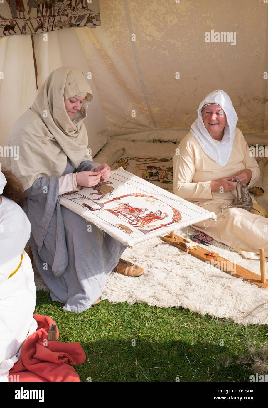 Viking women making a Tapestry at a historical reenactment. UK - Stock Image
