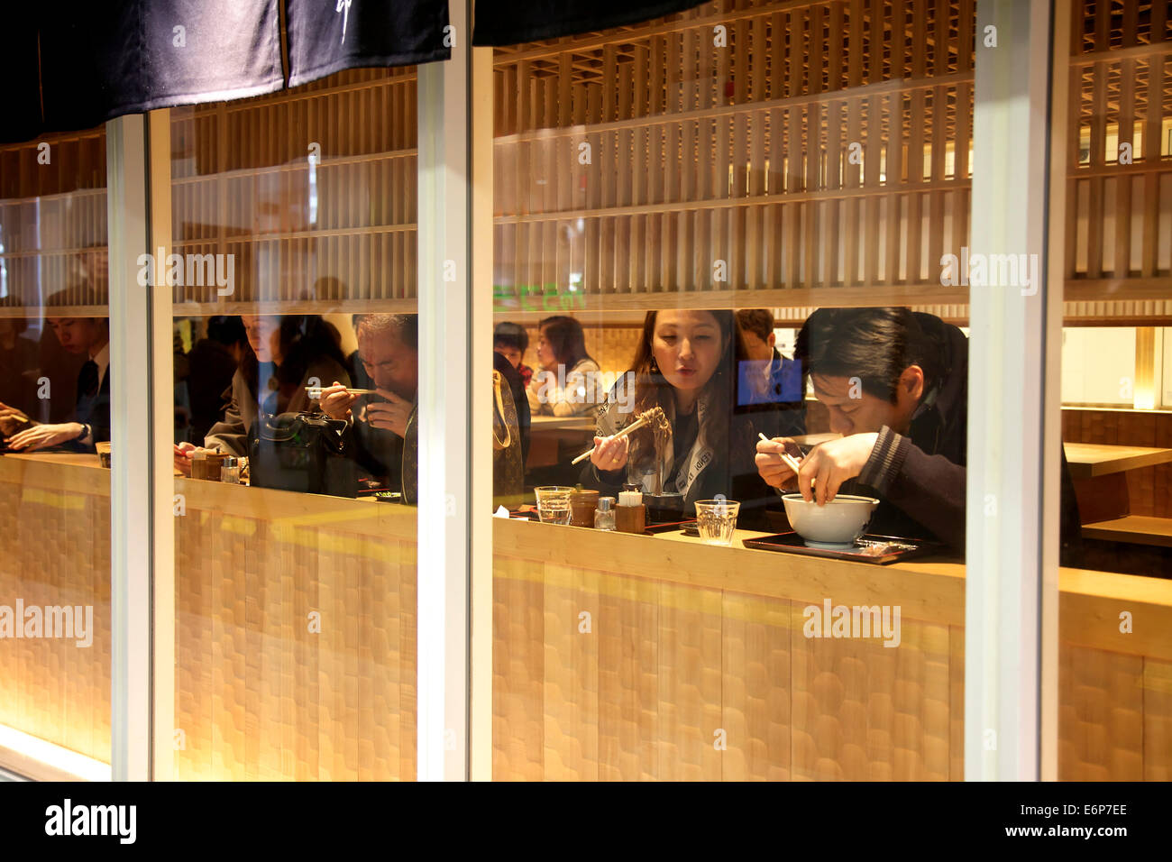 Japanese people eating noodle soup in restaurant. Tokyo, Japan, Asia - Stock Image