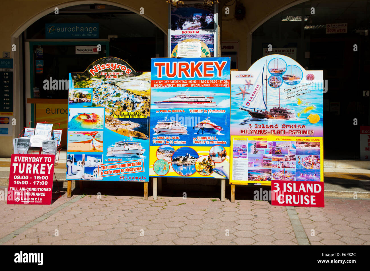 Signs advertising cruises and boat trips, Kos town, Kos island, Dodecanese islands, Greece, Europe - Stock Image