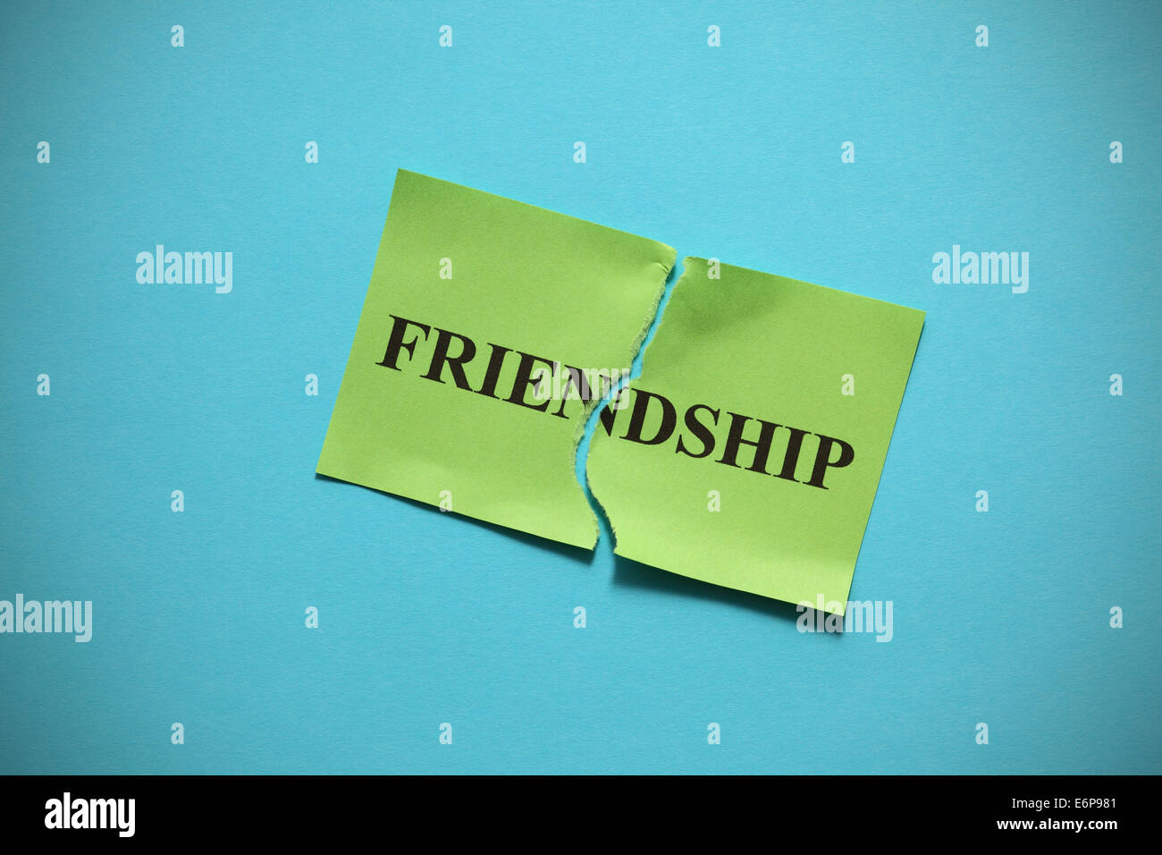 Friendship breakdown (destroy a friendship). Torn of paper with the word 'Friendship'. Concept Image. - Stock Image