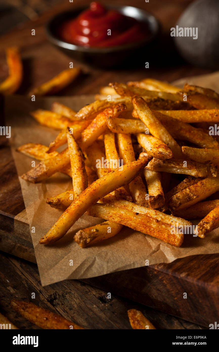 Cajun Seasoned French Fries with Organic Ketchup - Stock Image