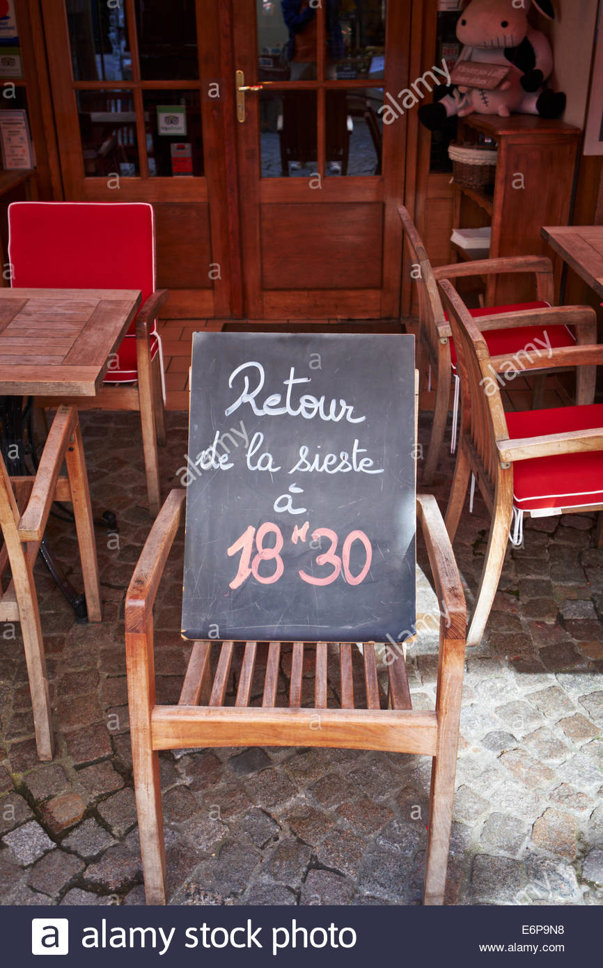 Creperie  blackboard sign open after siesta at 6:30pm , sense of humour. Blackboard sign outside restaurant Honfleur - Stock Image