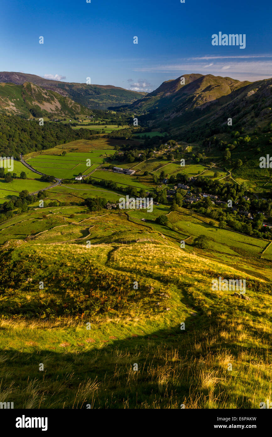 Looking down the path on the steep slopes of Hartsop Fell towards Place Fell & Ullswater in the distance, Lake - Stock Image