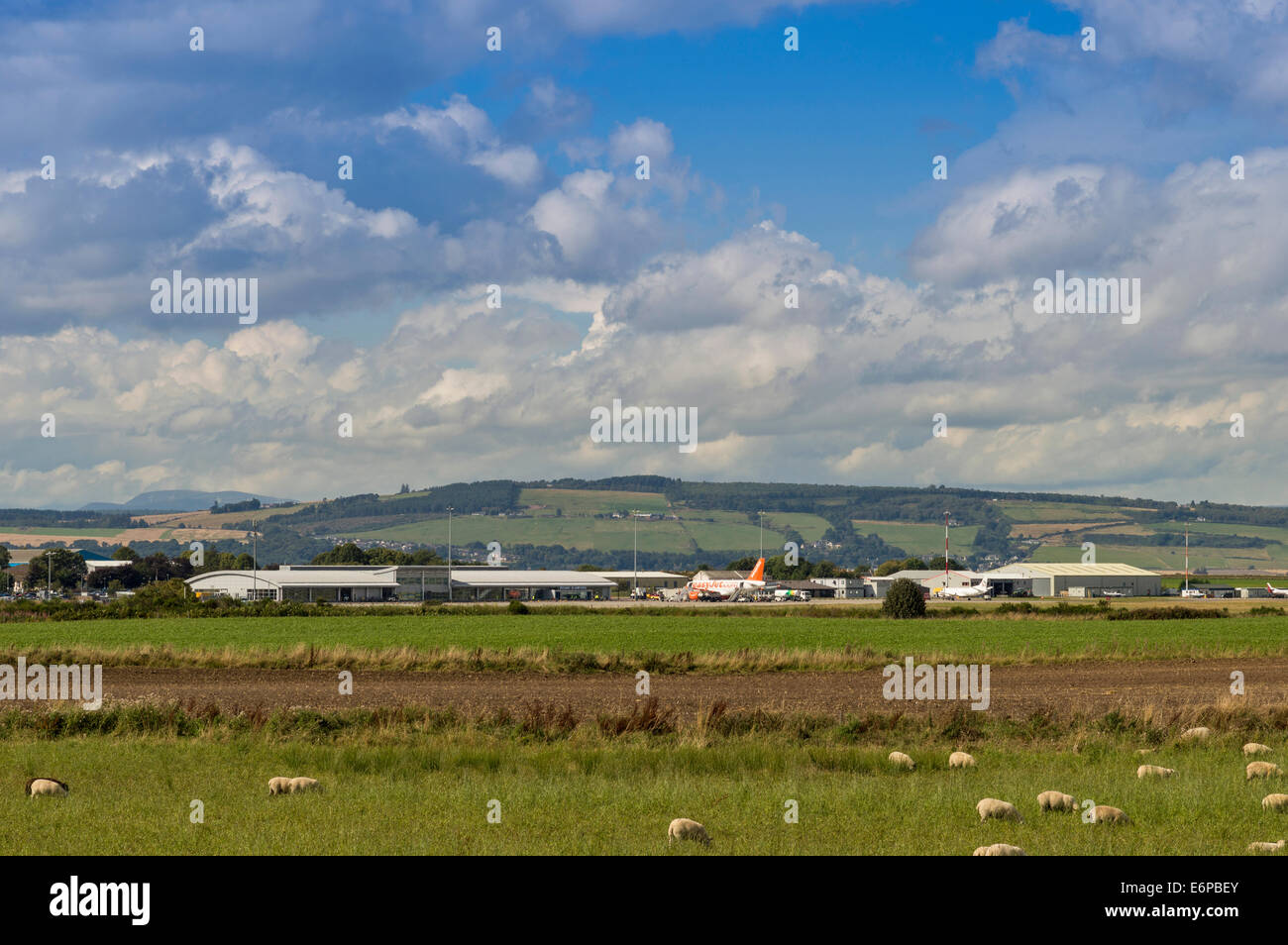 INVERNESS DALCROSS AIRPORT SCOTLAND AND FIELD WITH SHEEP - Stock Image