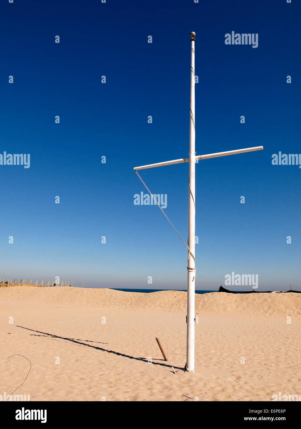 Mast or flagpole or cross on the beach at Point Pleasant Beach, New Jersey - Stock Image