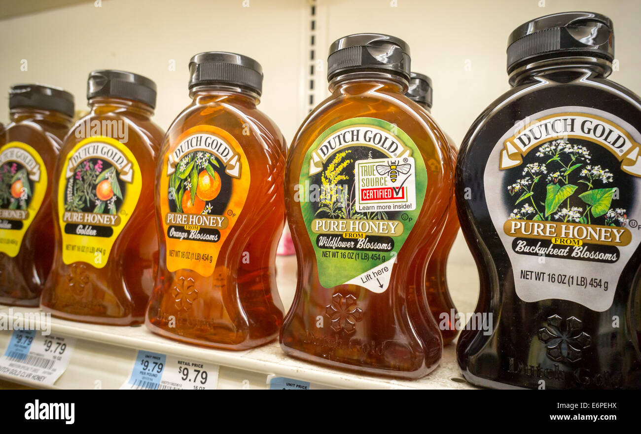 Bottles of 'product of the USA' honey are seen in a supermarket in New York - Stock Image