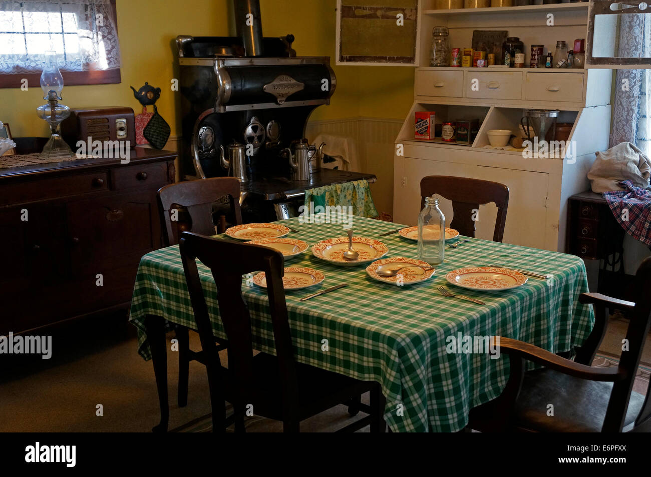 Old-fashioned kitchen and dining room in the Steveston Museum, Steveston Village, Richmond, British Columbia, Canada - Stock Image