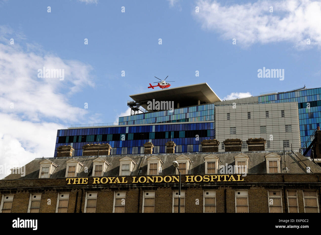 Air ambulance emergency helicopter landing on The Helipad on the roof of The Royal London Hospital Tower Hamlets - Stock Image