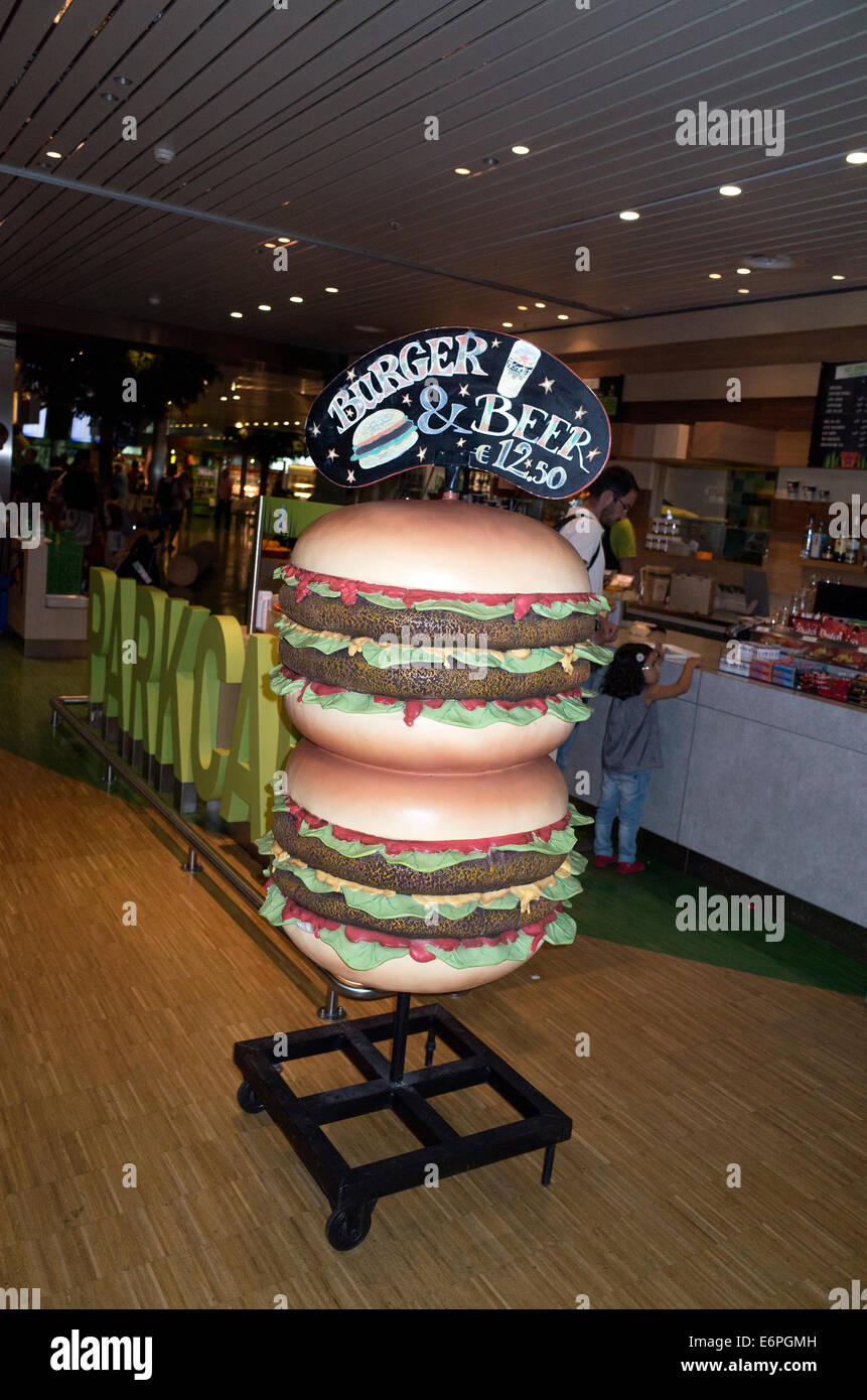 Life-size sculpture advertising two double burgers in the Schiphol Airport. Amsterdam Netherlands - Stock Image
