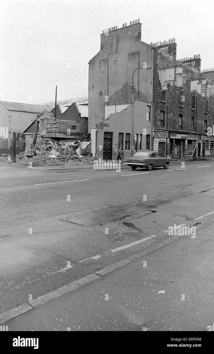 Tenements on Glasgow Road in Clydebank being demolished along with the John Brown's Shipyard gatehouse - Stock Image