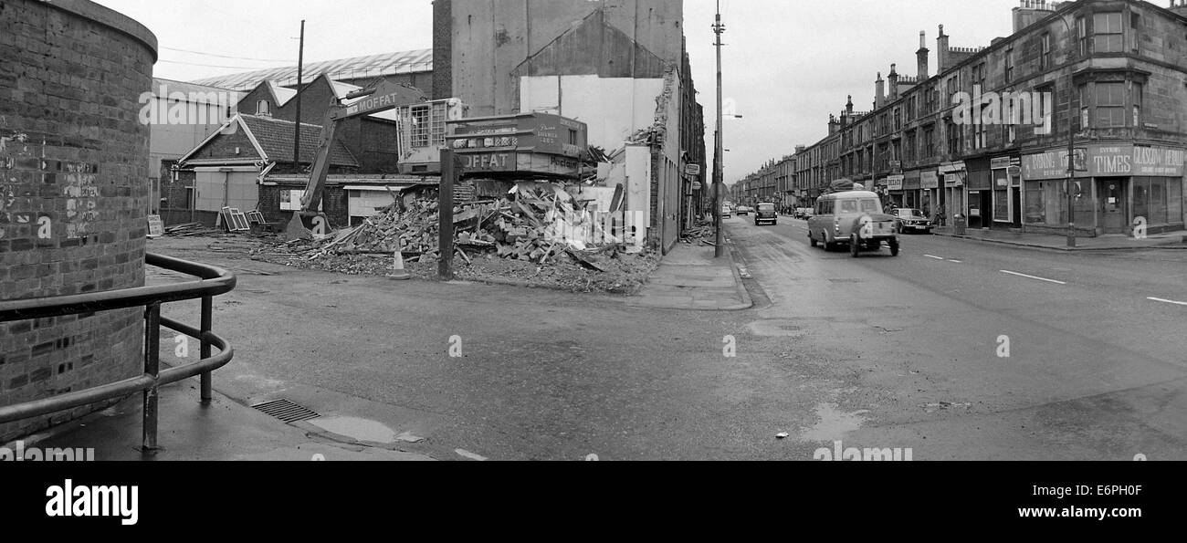 John Brown's Shipyard gatehouse being demolished, the old Evening Times office across the road, looking down - Stock Image