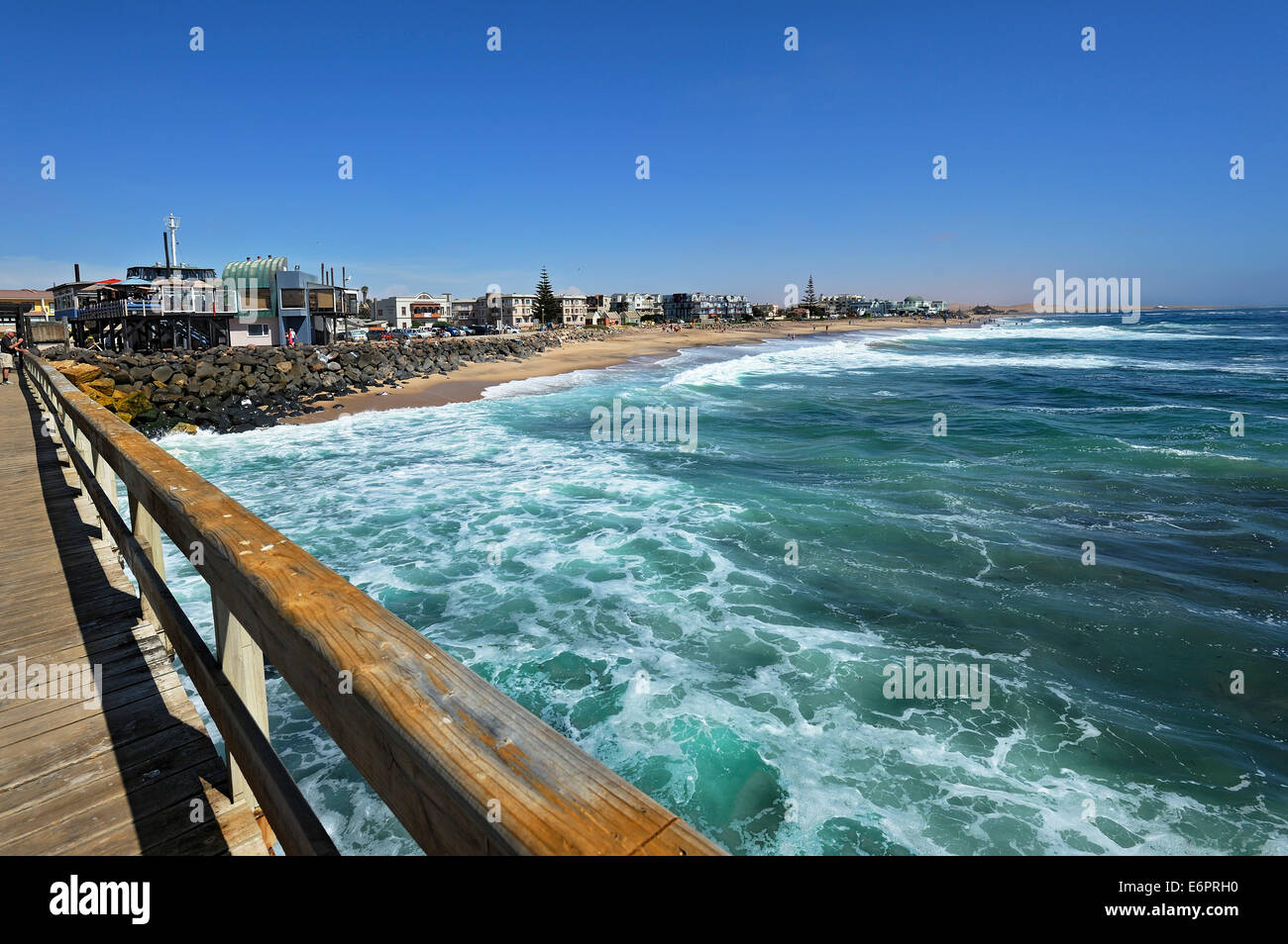 Wooden jetty and beach, Swakopmund, Namibia - Stock Image