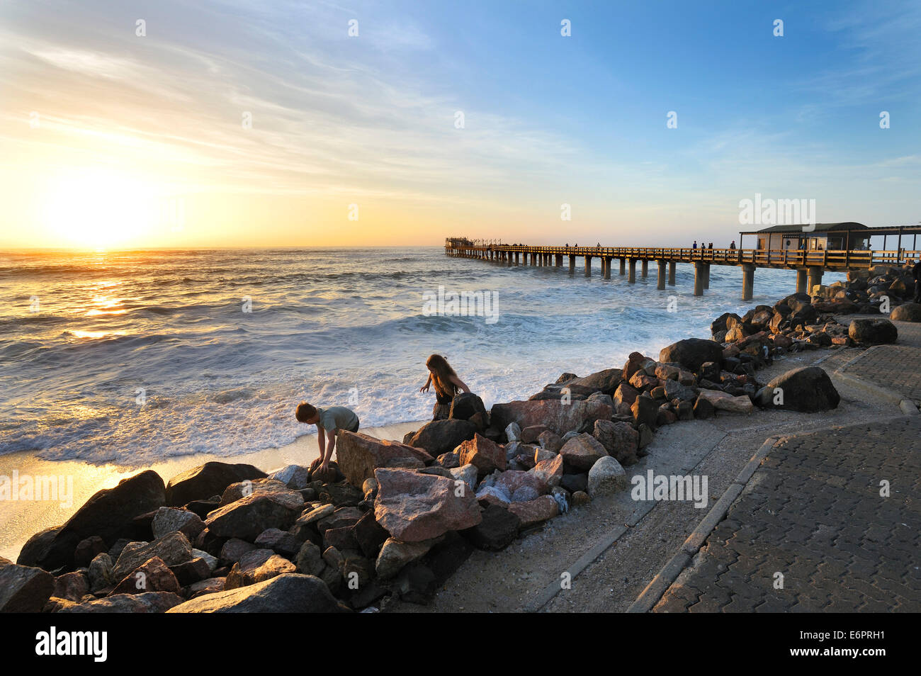 Sunset on the 325 meter long wooden jetty in Swakopmund, Namibia - Stock Image