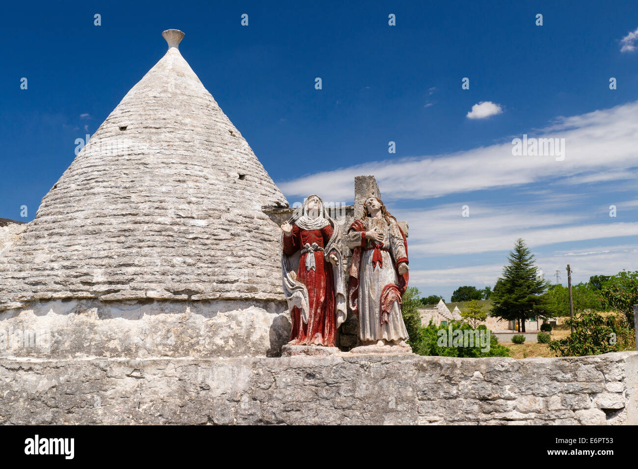 Saints, religious piety, Trullo, traditional round cone house, in Martina Franca, Valle d'Itria, Trulli Valley, Stock Photo