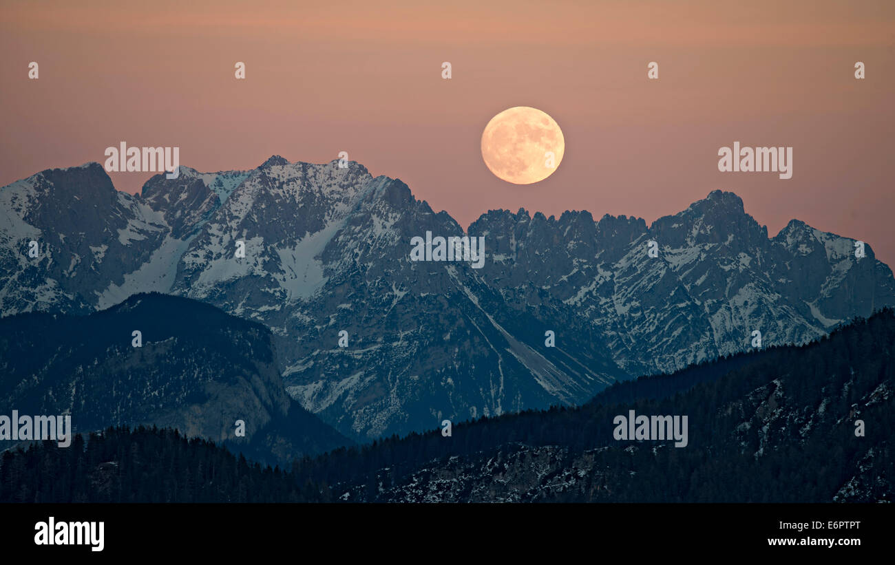 The full moon rising over the Kaiser Mountains, Tyrol, Austria - Stock Image