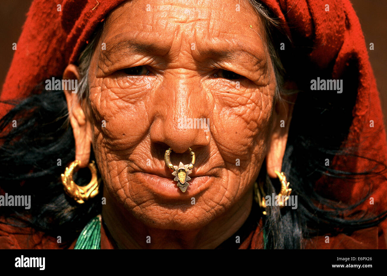 Woman wearing traditional jewelry ( Nepal) - Stock Image