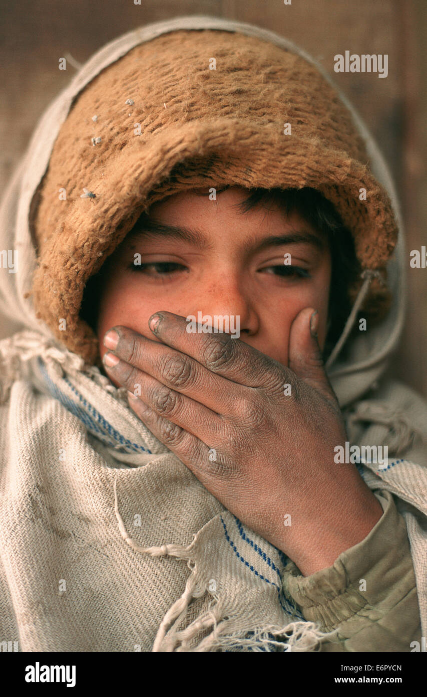 Shy boy working as a helper in a tea stall ( Pakistan) - Stock Image