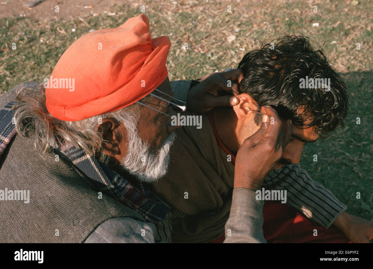 Ear cleaner at work ( Pakistan) - Stock Image