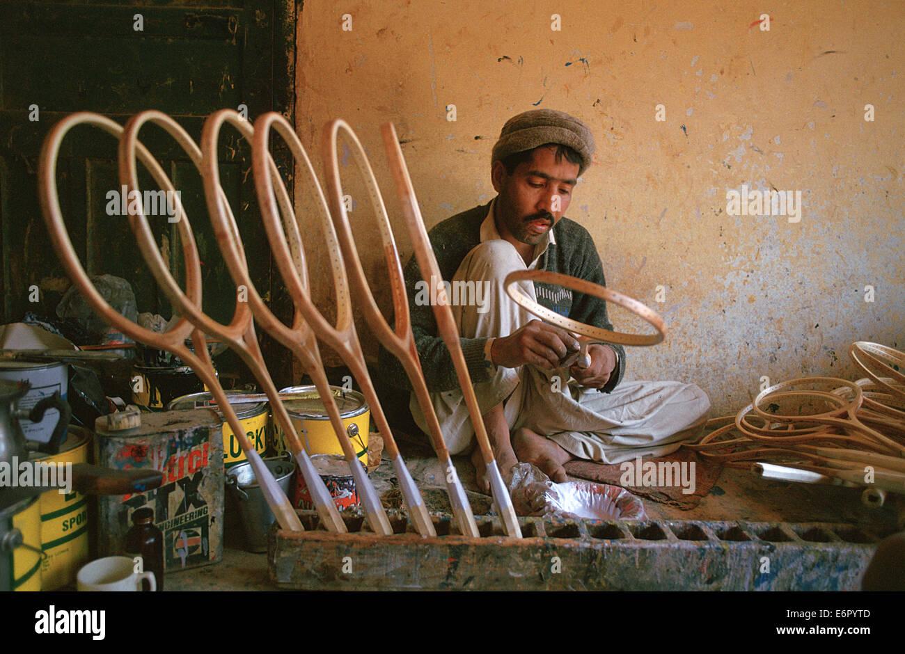 Man making tennis rackets ( Pakistan) - Stock Image