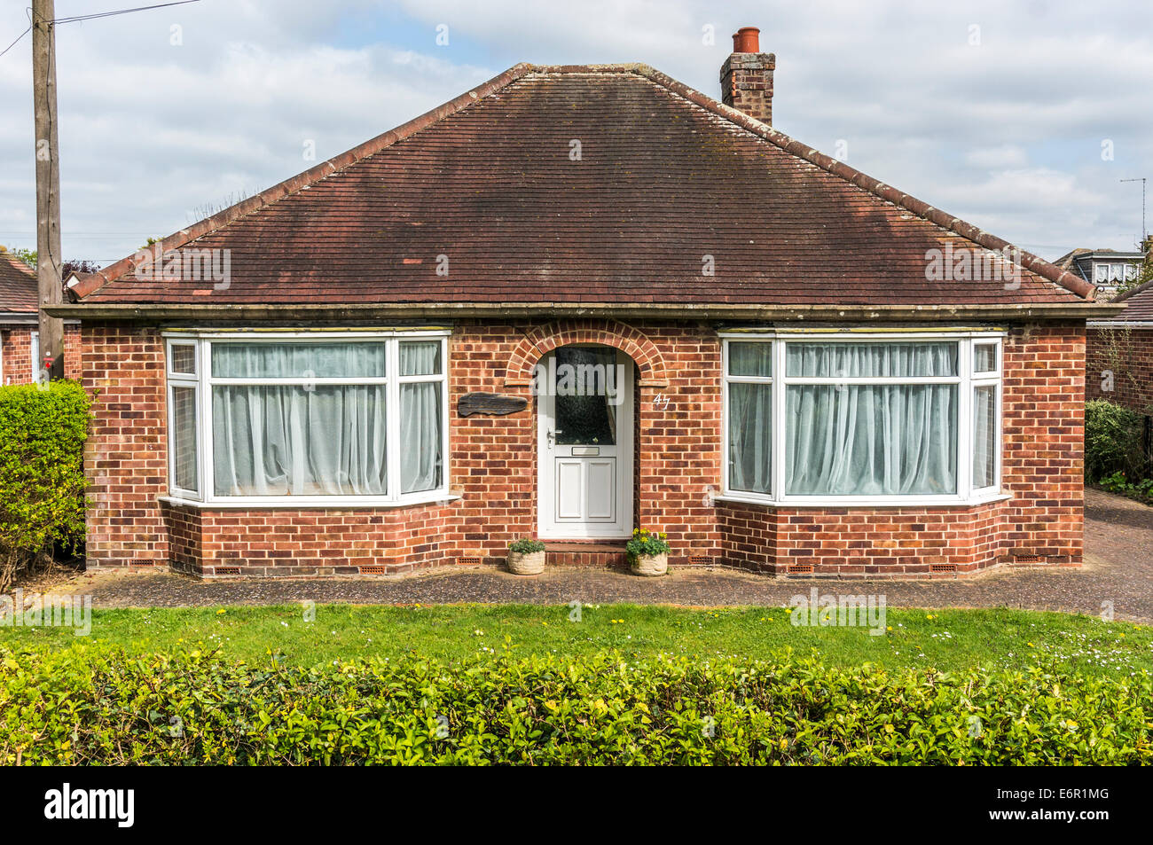 A 1950s detached period bungalow in Church Street, Northborough, Cambridgeshire, England, UK. - Stock Image
