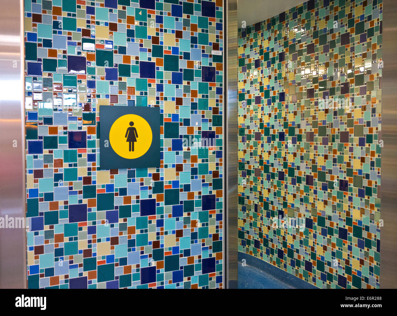 Colorful tile mosaic pattern on walls of entrance to women\'s ...