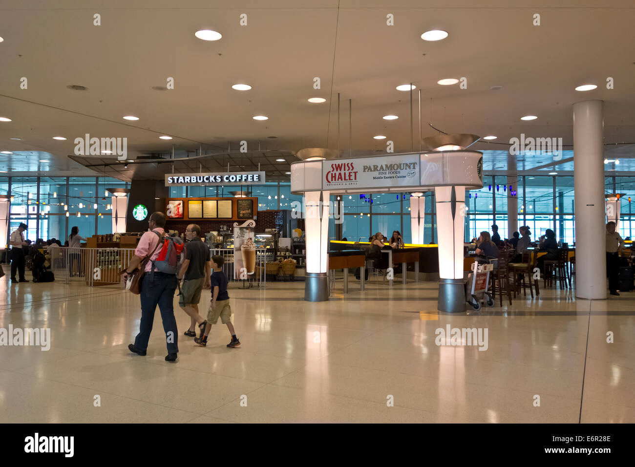 Restaurants and dining at Toronto Pearson International Airport.  Swiss Chalet and Starbucks in the airport terminal - Stock Image