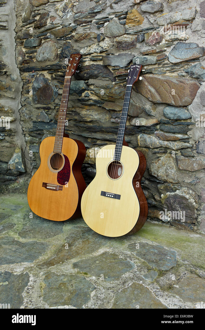 6 string Martin normal guitar and 4 string Gold Tone tenor guitar - Stock Image