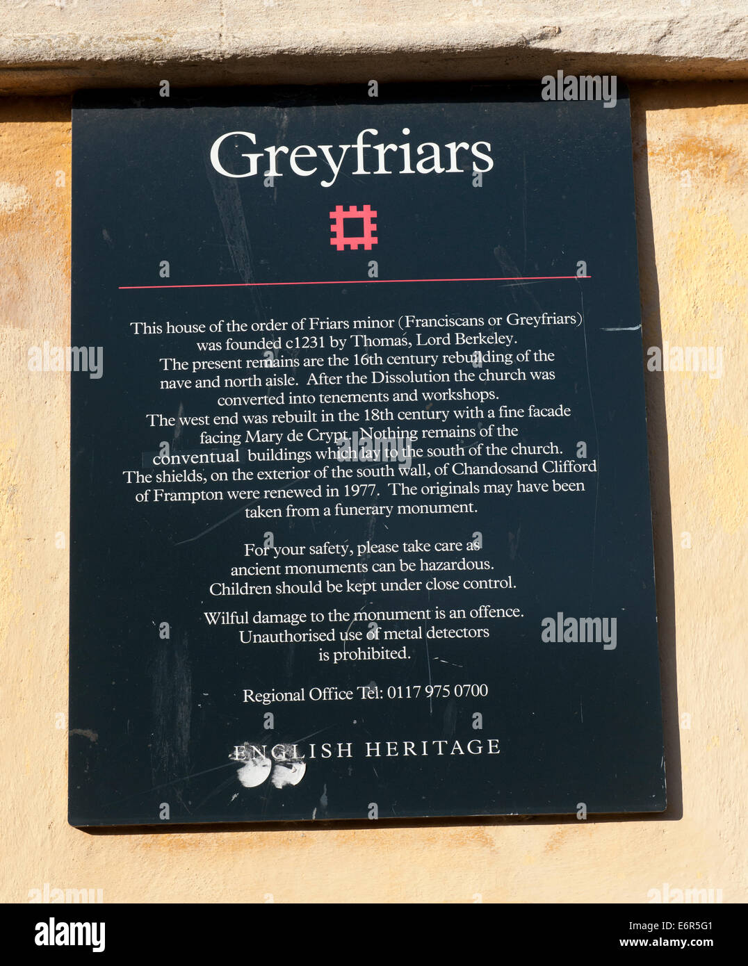 English Heritage plaque on the wall of Greyfriars an historic monastic house in the City Centre of Gloucester, Gloucestershire. - Stock Image