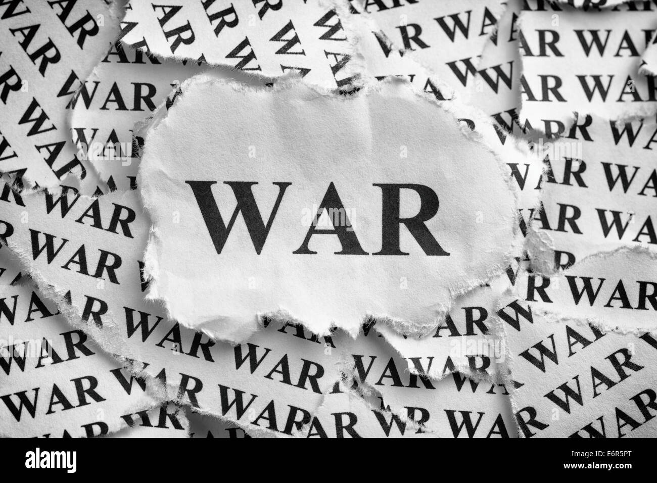 "Torn pieces of paper with the word ""War"". Concept Image ..."
