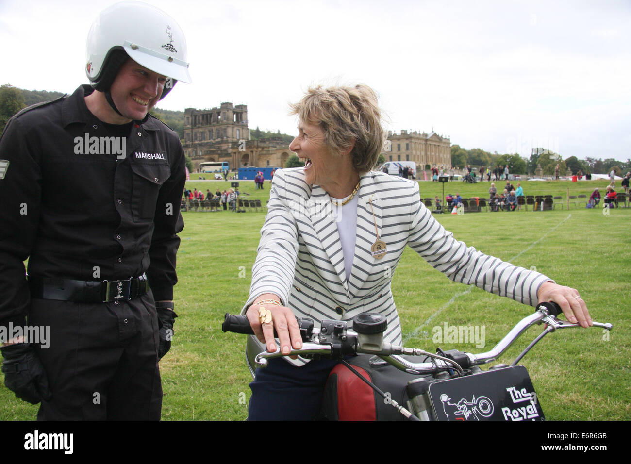 Peak District, Derbyshire, UK.  29 August 2014. The Duchess of Devonshire tries out a 750cc Triumph motorcycle belonging - Stock Image