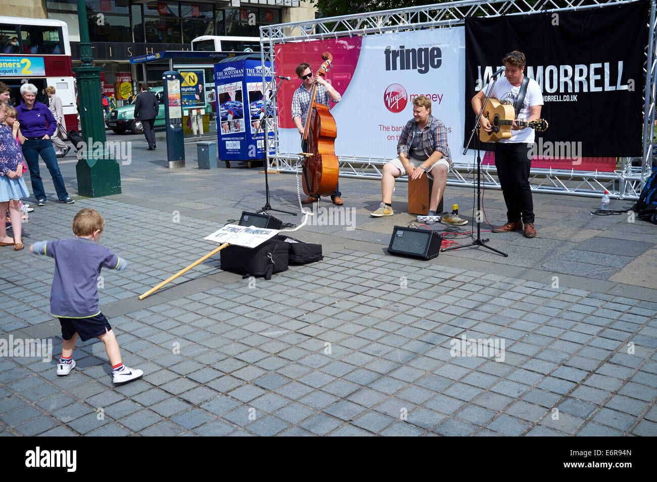 Edinburgh Festival 2014, Edinburgh, Scotland, small boy dancing to band - Stock Image
