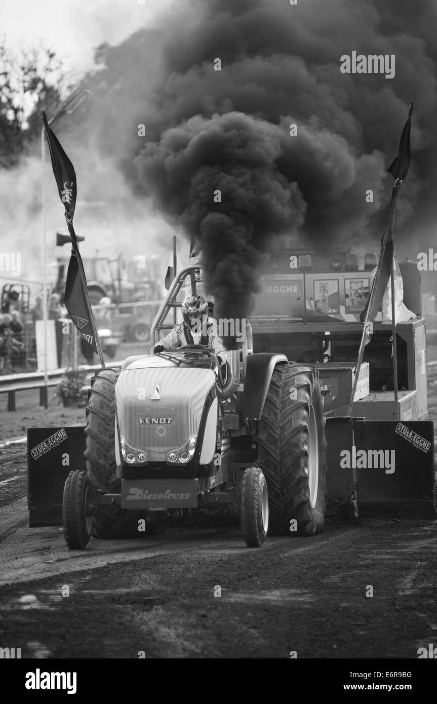 black smoke bellowing from a Pro Stock Tractor at a tractor pulling event emission emissions test testing emission - Stock Image