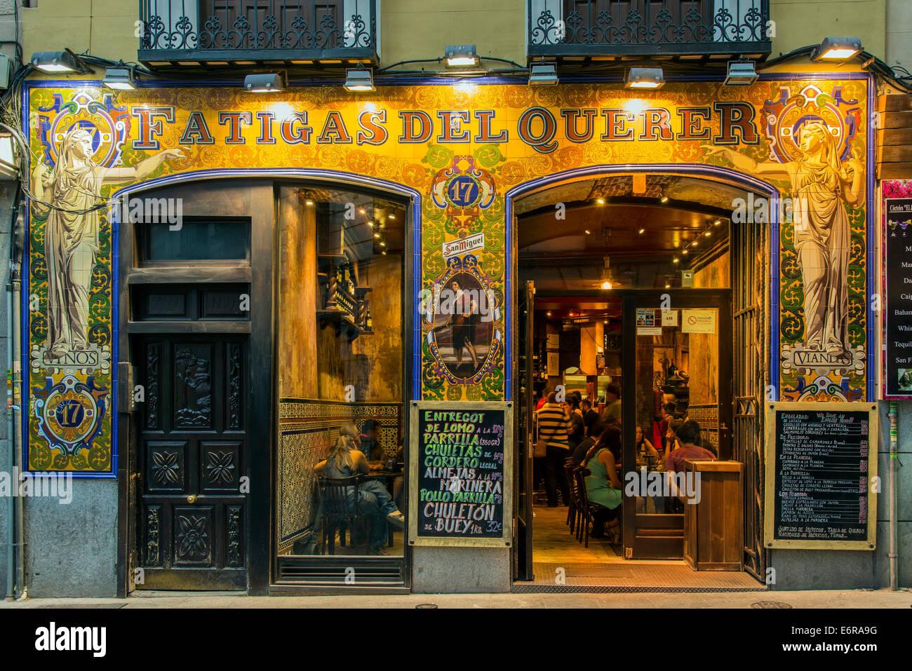 Night exterior view of a bar restaurant in Calle de la Cruz, Madrid, Comunidad de Madrid, Spain - Stock Image