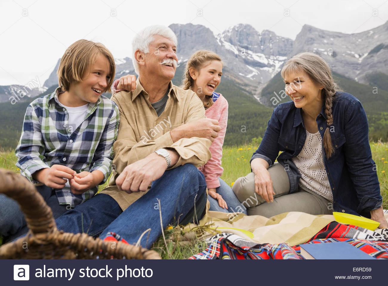 Family having picnic in rural field - Stock Image