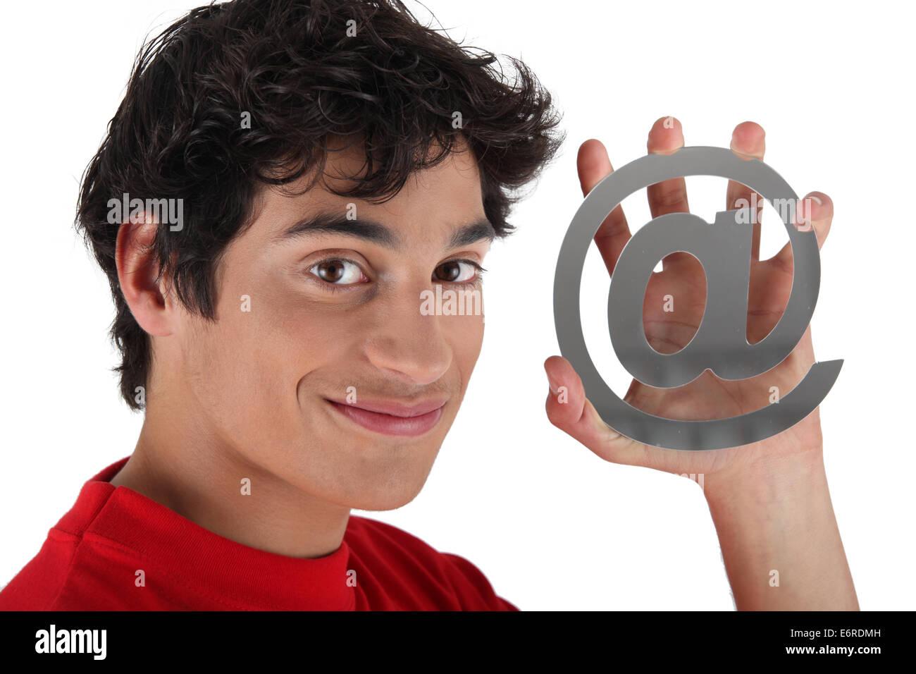 Man holding at symbol - Stock Image