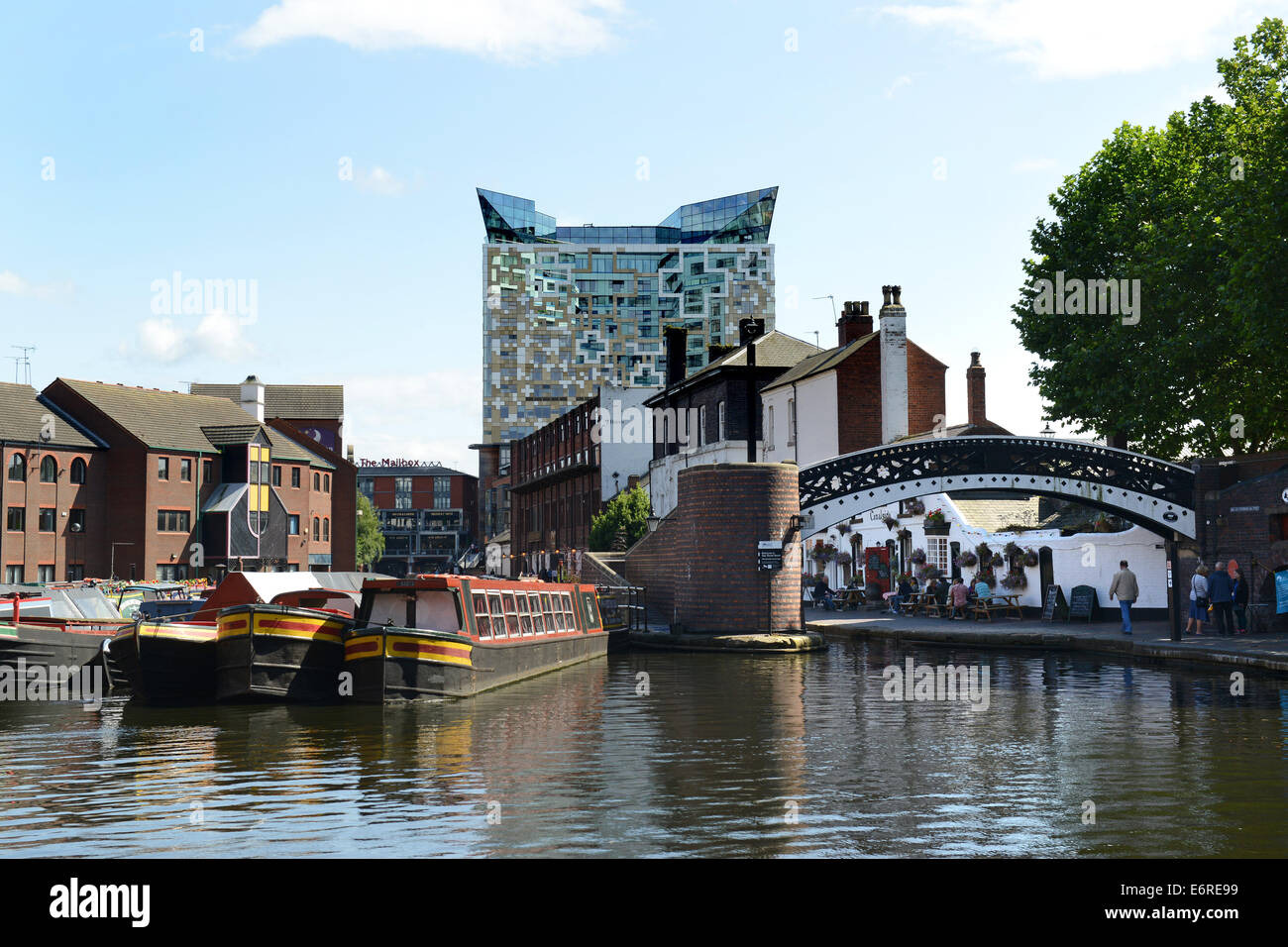 Birmingham canals waterways narrowboats at Broad Canal Basin with the Cube building Uk - Stock Image