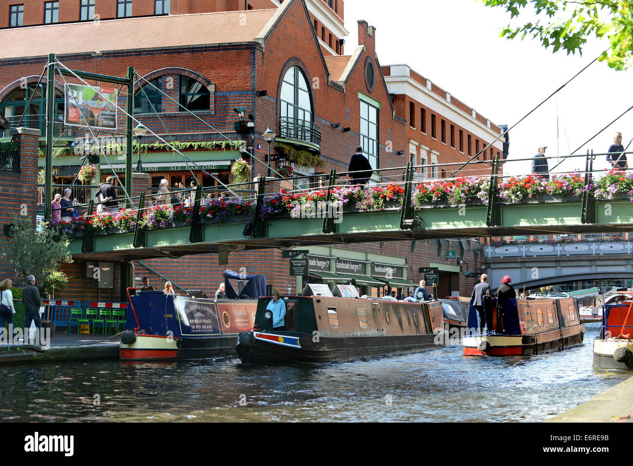 Birmingham canals waterways narrowboats on canal at Brindley Place Uk - Stock Image
