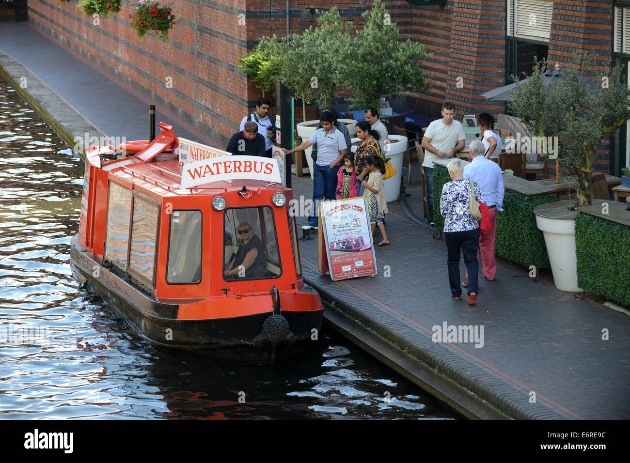 Birmingham canals waterways Waterbus on canal at Brindley Place Uk - Stock Image